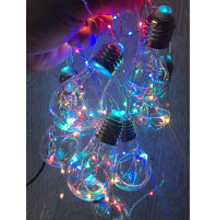 Multicolored LED Christmas lights in the form of old E27 bulbs