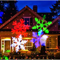 Star shower laser magic light projector WITH SNOWFLAKES. Light up your house before Christmas.
