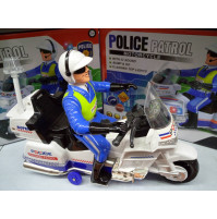 Toy Police officer on a motorcycle with light music