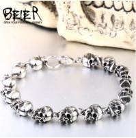 Stylish men's bracelet with skulls in stainless steel