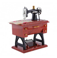 Music box in the form of a sewing machine