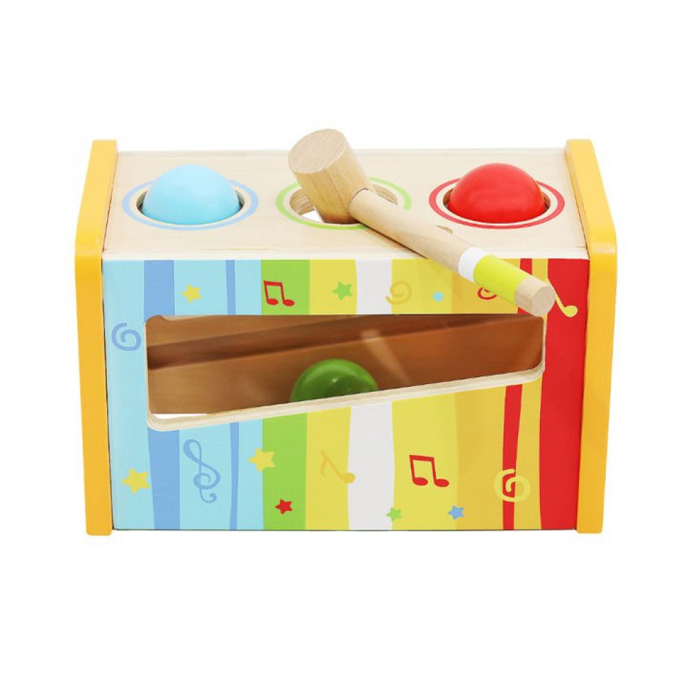 Children's educational musical instrument - a xylophone with sensory balls, a hammer and a drum stick